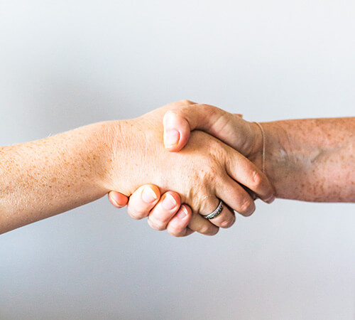 Shot of a handshake on a white background